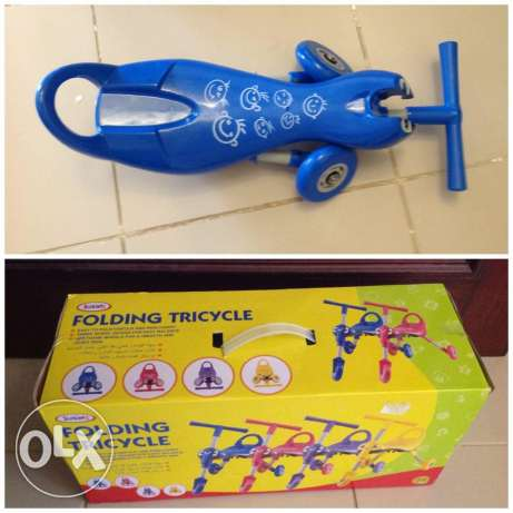 Juniors folding tricycle - new