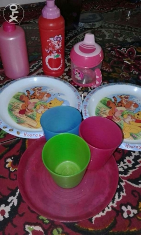 children feeding cups and plates