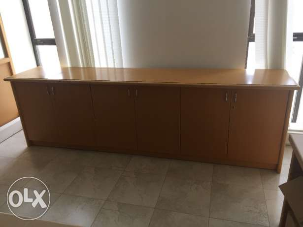 Long wooden table with shelves