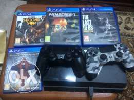 PS4 with 2 controllers + 4 games + 1 controller cover