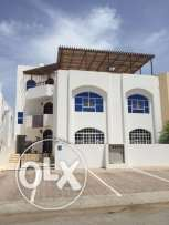Building for sale t in Khuwair 33, second line of the main road