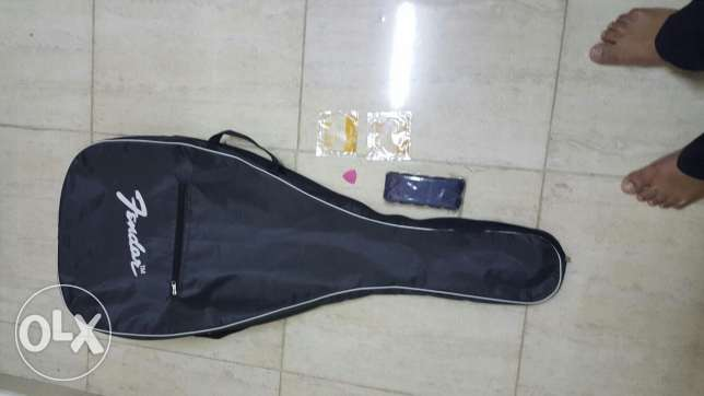 New 01 COVER for guitar, new 01 BELT,new 02 string E & B al in 10-OMR السيب -  4