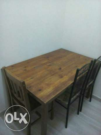 Urgent sale Small wooden dining table with 3 chairs مسقط -  1