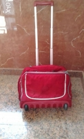 Red hand luggage