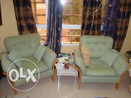 Couch and two wood chairs set