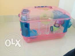 Hamster cage with food and cage wheat