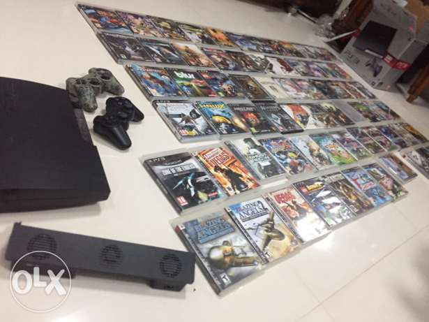 PS3 with 2 controller and 67top games in very good condition for sale