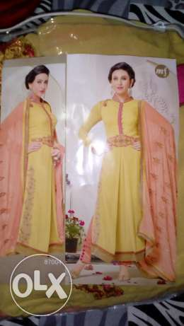 New unstitched emb suit صحار -  1
