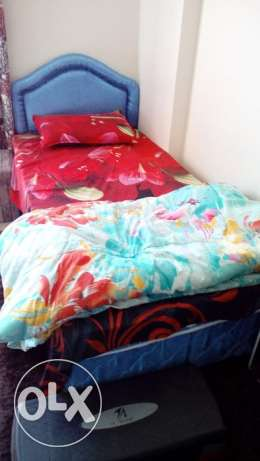 Sparingly used single Bed with medical mattress for immediate sale