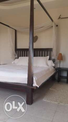 Custom made solid wood king-size bed with 2 side tables
