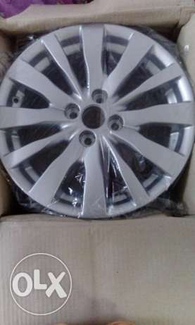 4 nos Suzuki swift alloy wheels.unused