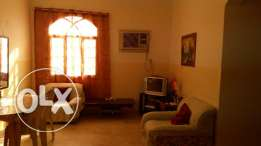 Room for rent with attached bathroom,Al khoud souk,along the road.