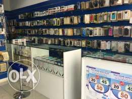 Running Mobile accessories for sale at prime location in Ghubra