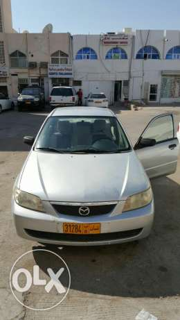 Mazada 323 with one year passing want to sale مسقط -  1