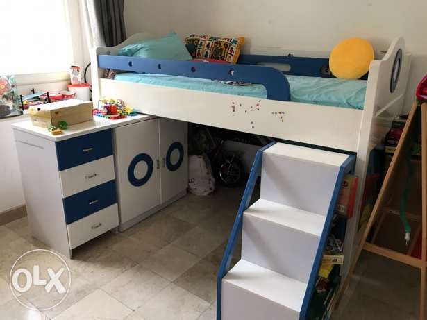 kids bunk bed with matching small bookshelf/ cupboard and desk