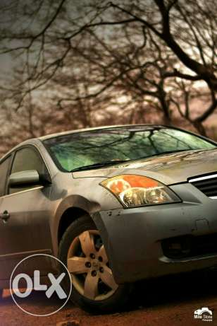 Nissan Altima 2009 Coupe رقم 1 Urgent Sale leaving country