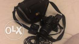 Nikon camera D5000 for sale with its lens, protection bag, memory card