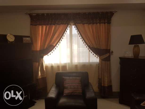 3 x Lovely Curtains with poles and tie-backs.
