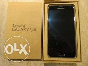 Samsung Galaxy S5 SM-G900H Golden edition for sale.