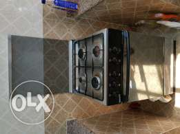 4 burner gas stove in perfect condition with gas cylinde.