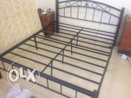 Queen size iron bed frame for sale.