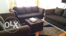 Sofa 3+2+2 with carpet and curtains.