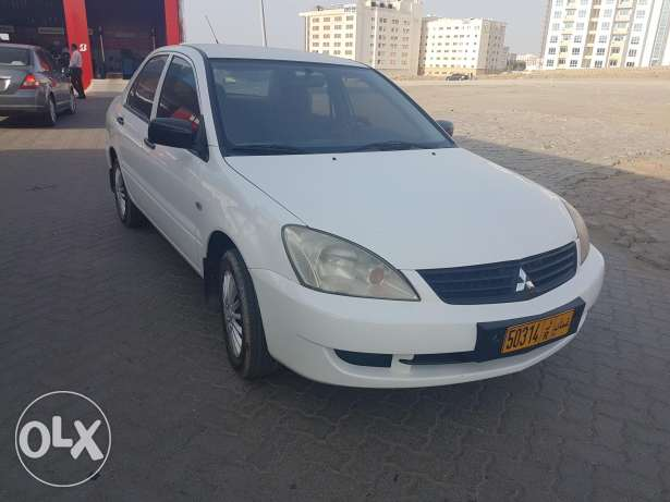 lancer model 2011 good condition free accident 1.6 cc