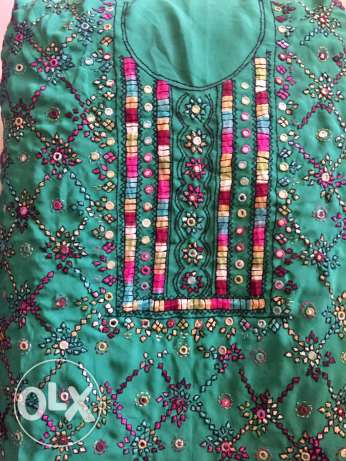 beautiful balochi and shisha work on both sides and on sleeve