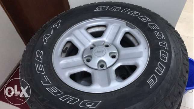 Jeep Wrangler stock rim and tire( Bridgestone)