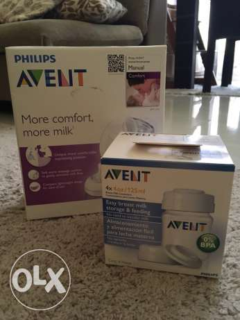 Avent - Manual Breast Milk Pump and 4 storage and feeding containers.