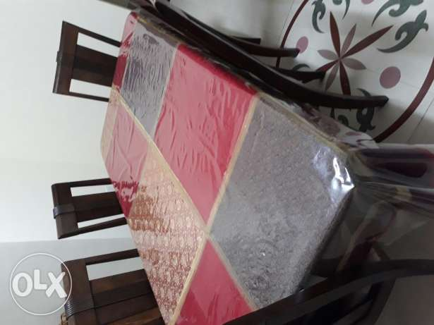 Dining table set..6 wooden chairs with mahogany brown table