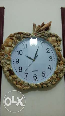 Wall clock made of sea shells