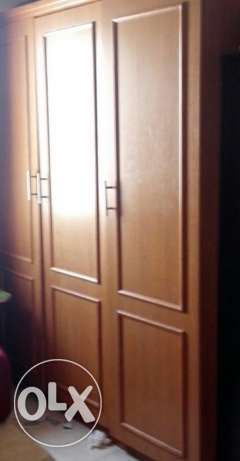 Three door teak wood wardrobe