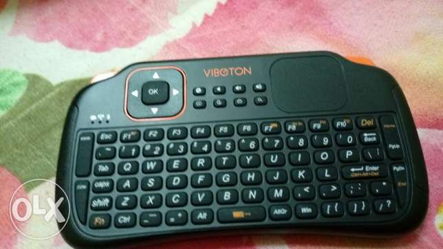 Wireless keypad with touchpad for L.E.D