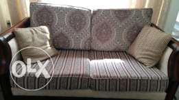 2× 2 seater sofa for sale. Solid wooden frame.