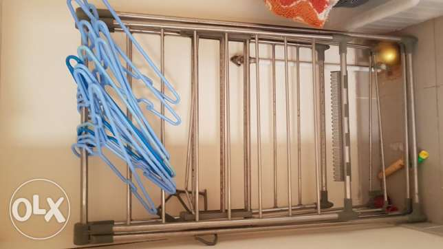 Clothes dryer with hangers